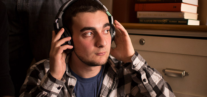 Nick Canonico records sound on the set of the Mason Film Lab. Photo by William Dickson.