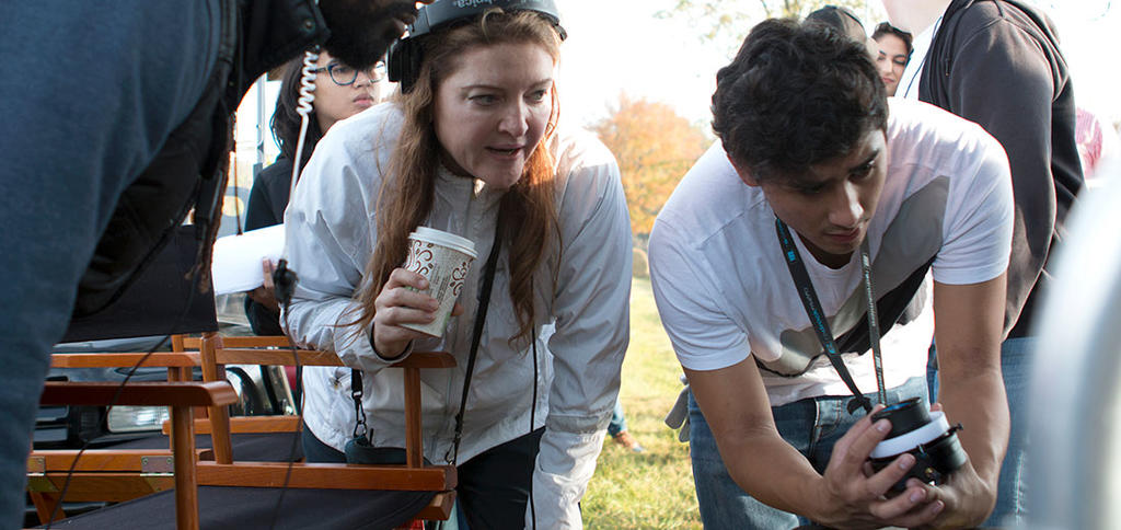Students work on set with writer, director, and television series creator Colette Burson on location. Photo: Sarah Heaton.